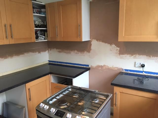 Kitchen wall re-plastered in Cheadle