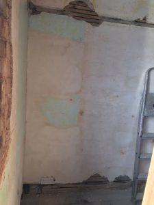 Loose plaster on main walls