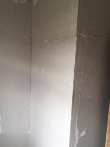Replastered walls of box room