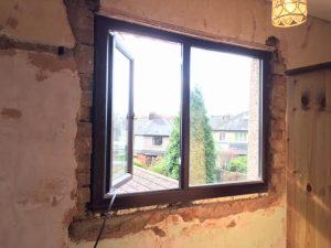 Window damaged, loose plaster.