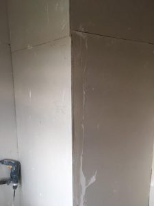 plaster boarded walls of box room in Cheadle