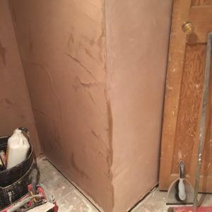 plastered corner wall of plaster